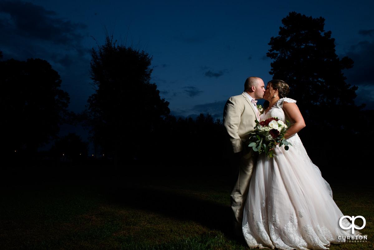Bride and groom kissing at sunset at The Grove at Pennington.