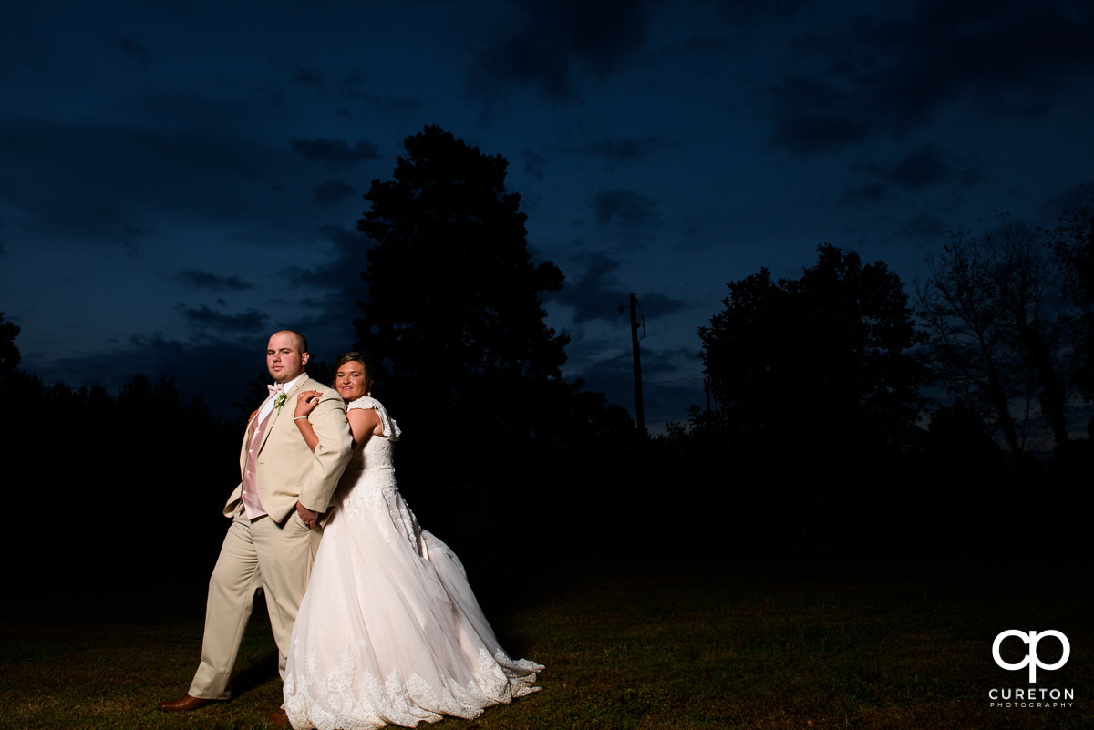 Bride and groom in front of an epic sky at The Grove at Pennington.
