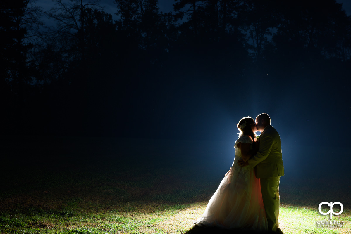 Creative backlit photo of a bride and groom at The Grove at Pennington.
