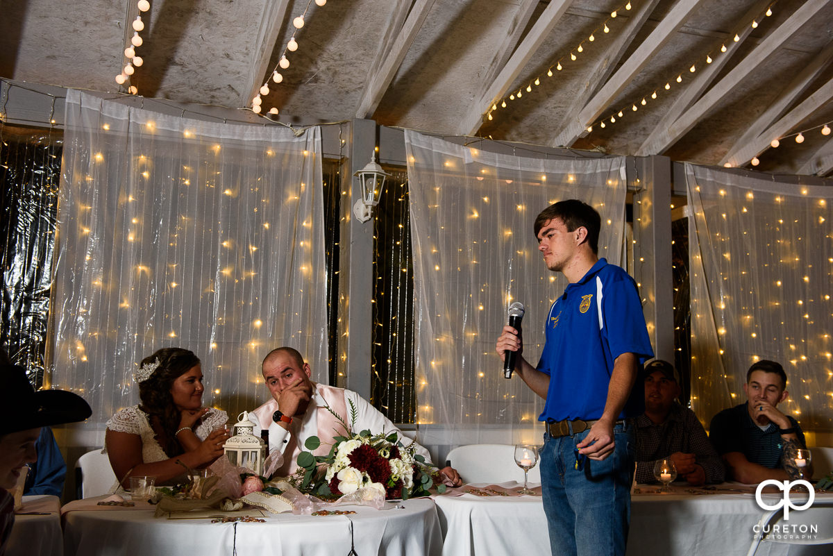 Groom's brother toasts the couple.