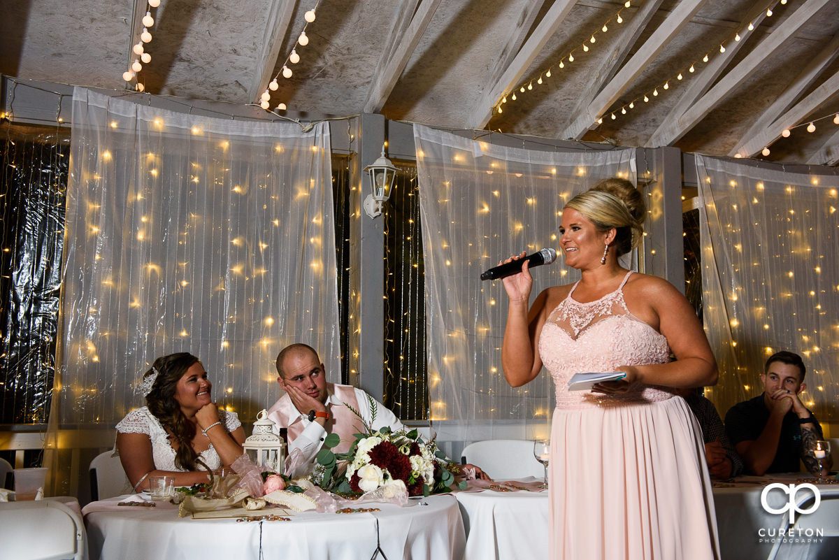 Bride's sister toasts the couple.