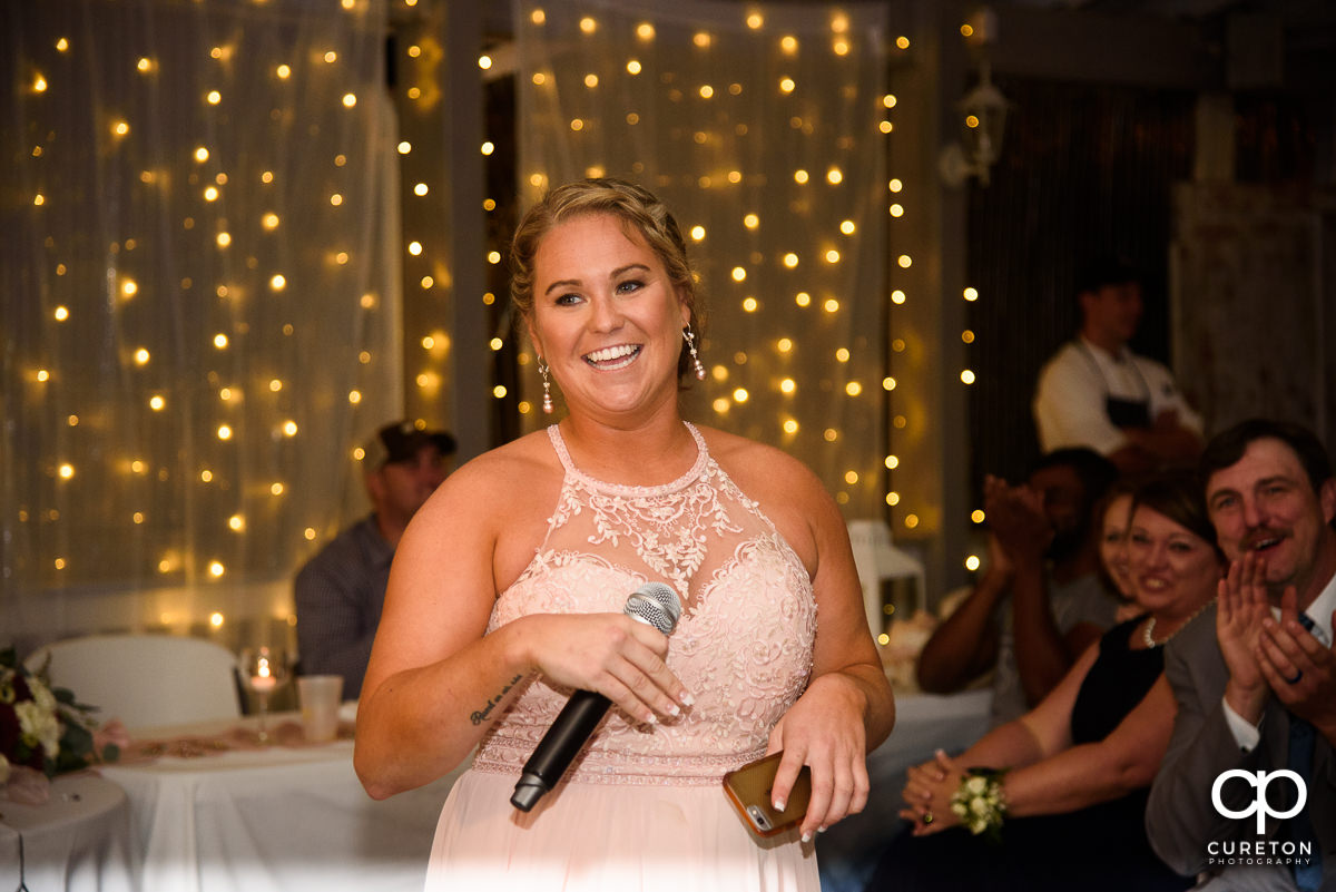 Bride's sister sings them a song.