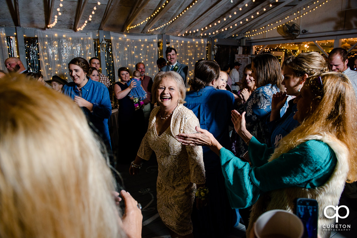 Bride's mom dancing at the reception.