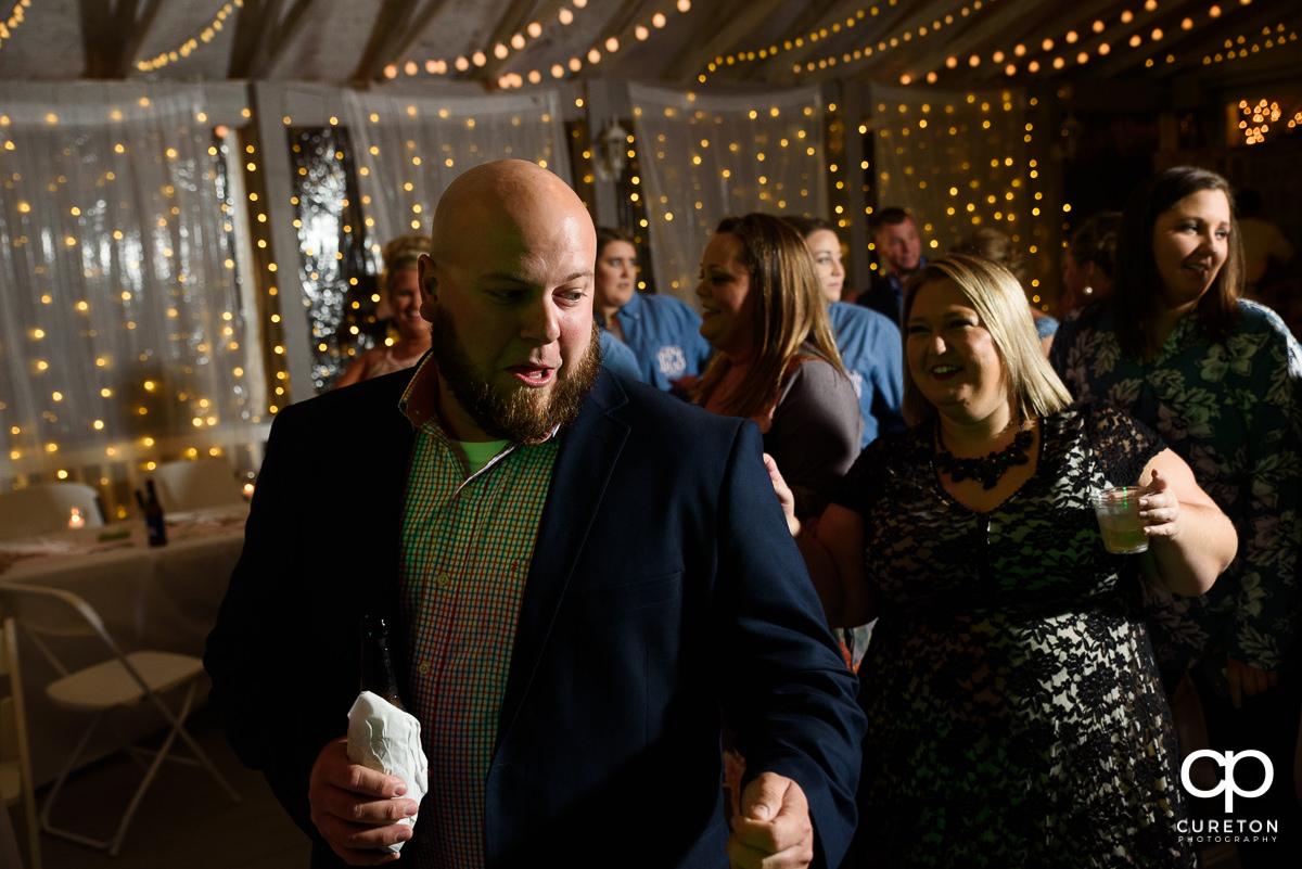 Wedding guests dancing at the reception at the Grove at Pennington.