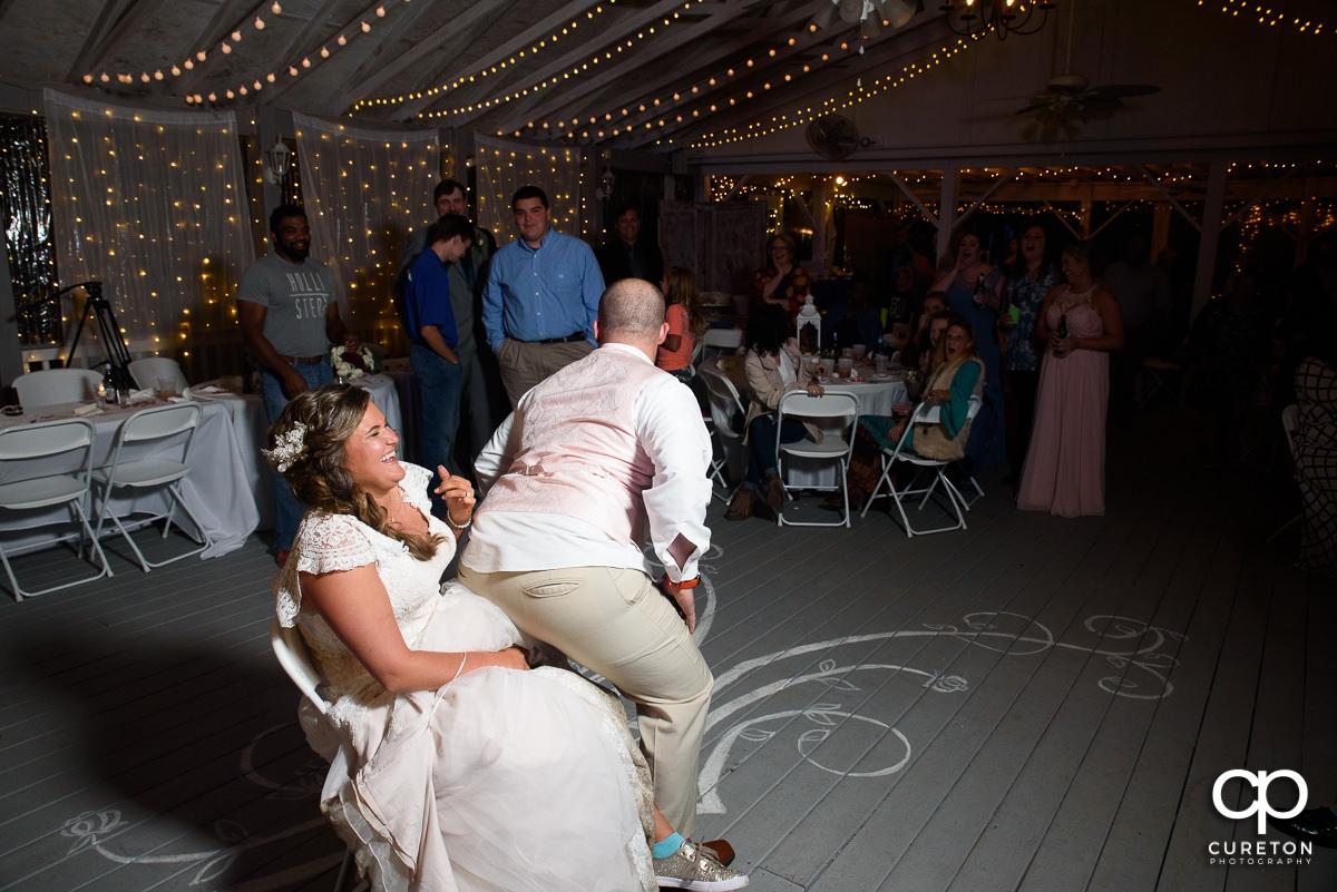 Groom grinding on the bride.