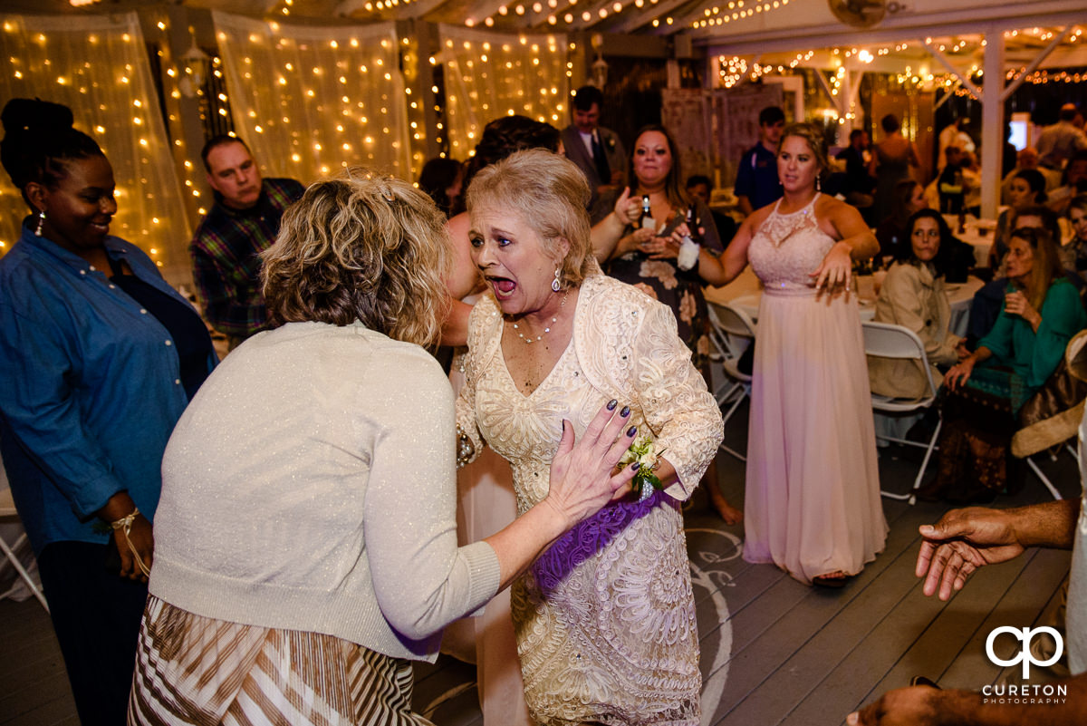 Mother of the bride dancing at the reception.