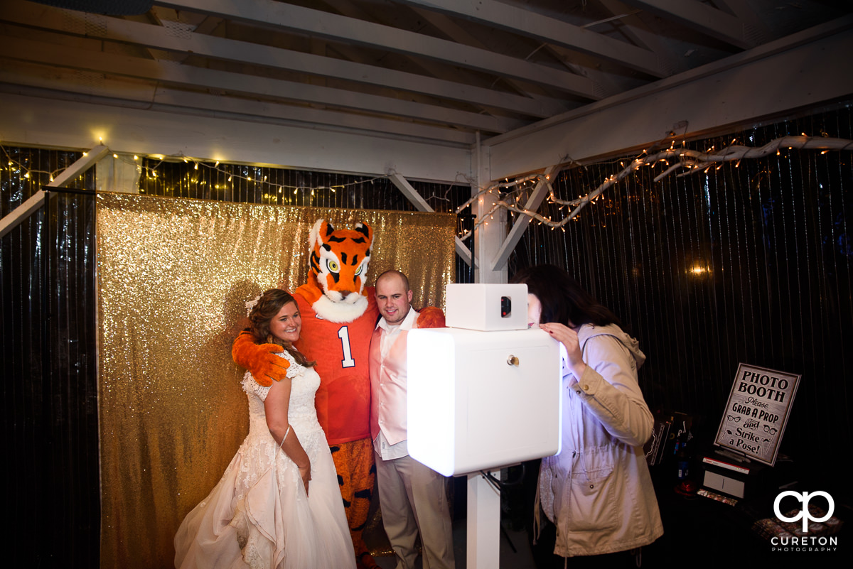 Clemson Tiger with the bride and groom in the Premiere Party Entertainment photo booth.