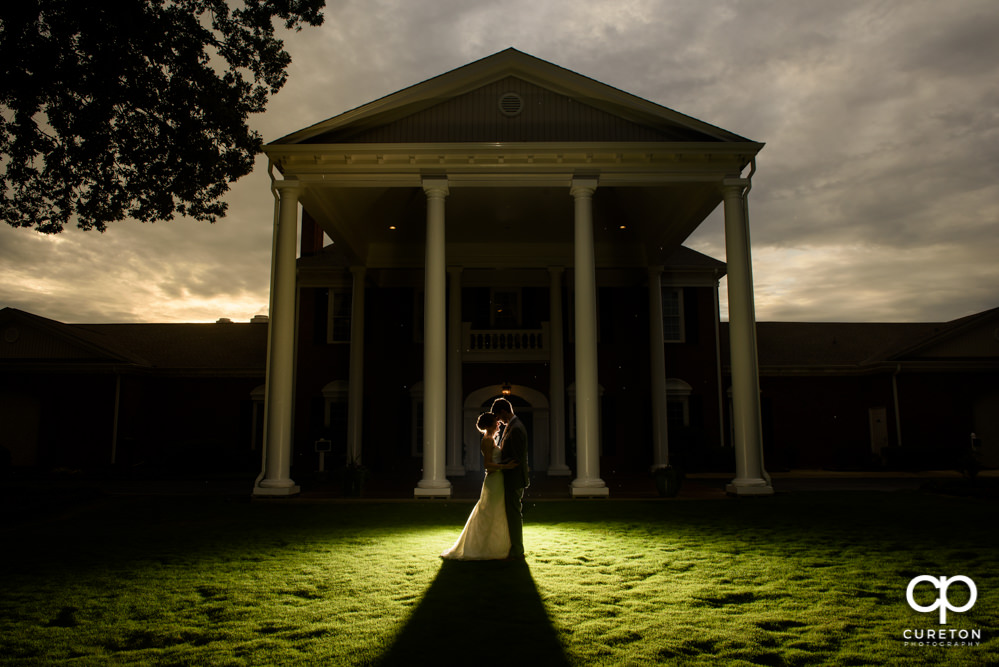 Bride and groom at sunset after their wedding at Holly Tree Country Club in Simpsonville,SC.