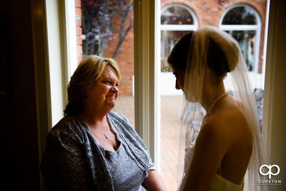 Bride and her mom sharing a pre-wedding moment.