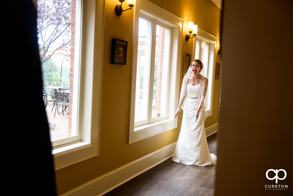 Bride sees her dad during a first look before the wedding.