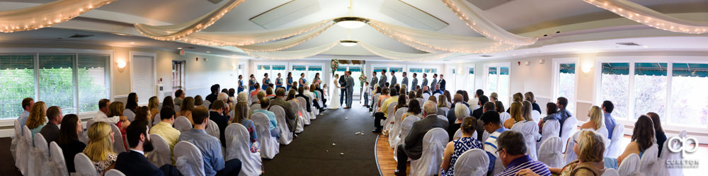 Wedding ceremony at Holly Tree Country Club inside.