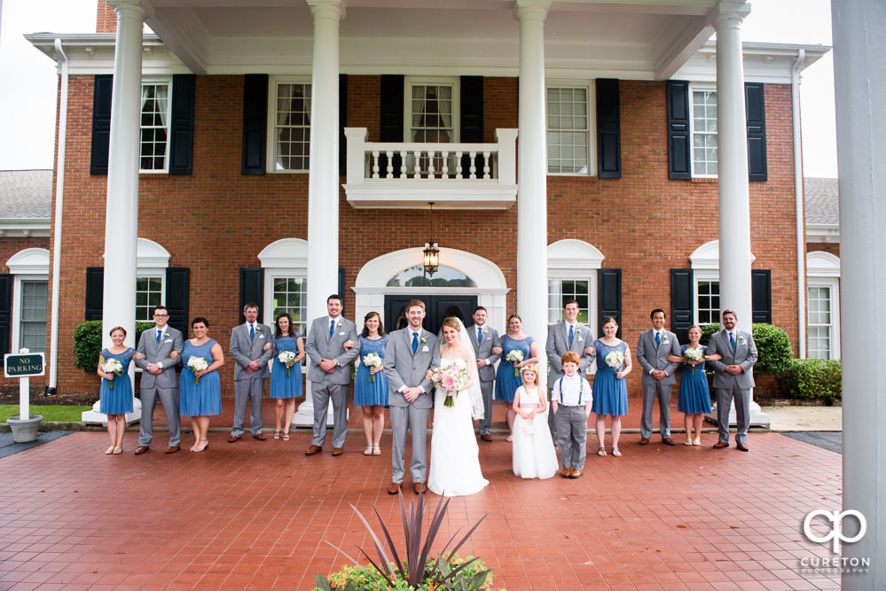 Wedding party in front of Holly Tree Country Club after the wedding ceremony.