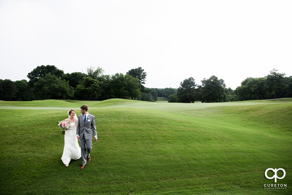 Bride and groom on the golf course.