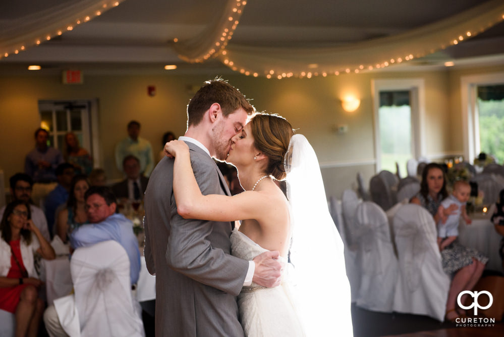 Bride and groom having their first dance at the wedding reception.