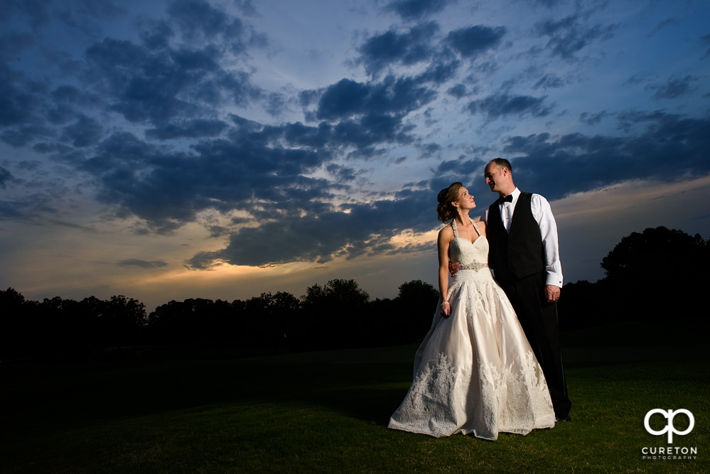Bride and Groom at sunset on the golf course after their Holly Tree Country Club wedding