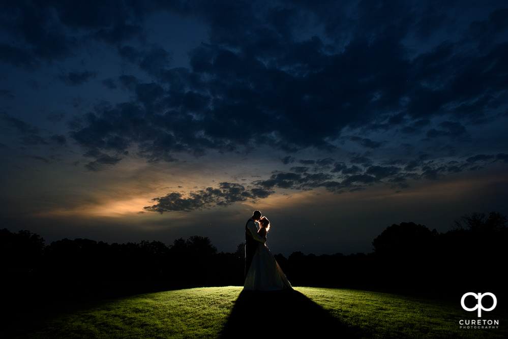 Bride and Groom at sunset on the course after their Holly Tree Country Club wedding reception.