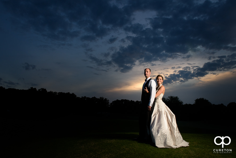 Bride and groom at sunset at Holly Tree.