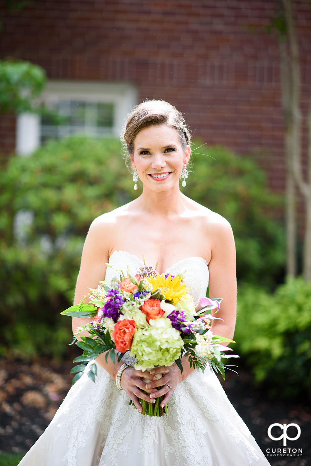 Bride in the courtyard at Mauldin United Methodist Church.