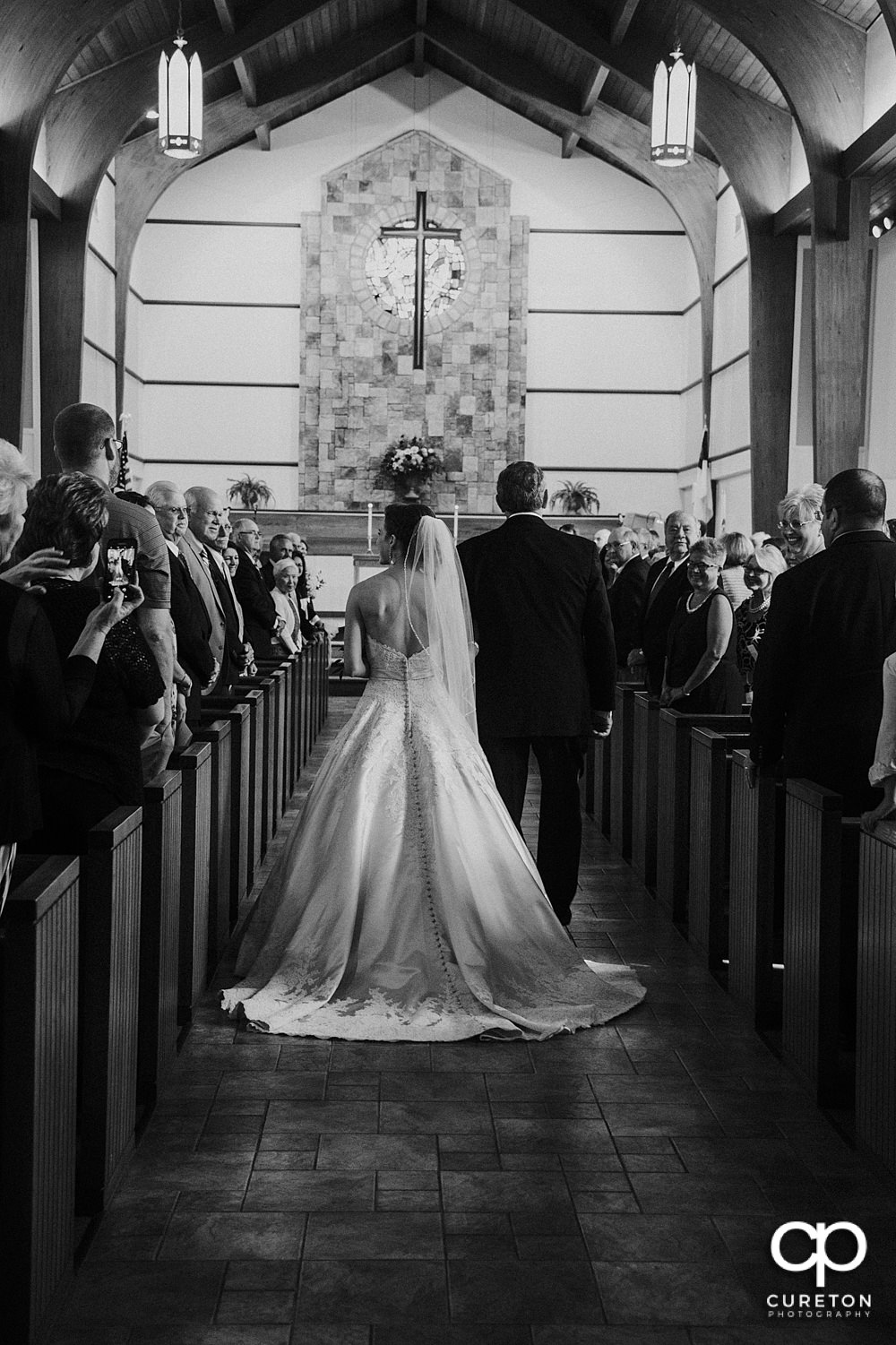 Bride and her father walking down the aisle at the wedding ceremony at Mauldin United Methodist.