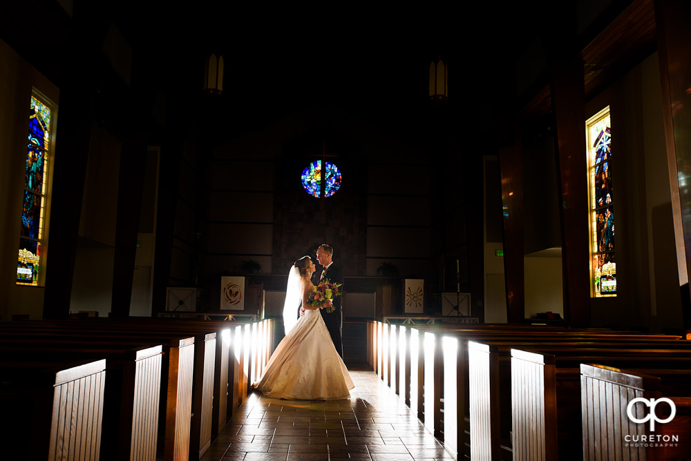 Bride and groom in the sanctuary at Mauldin United Methodist after their wedding.