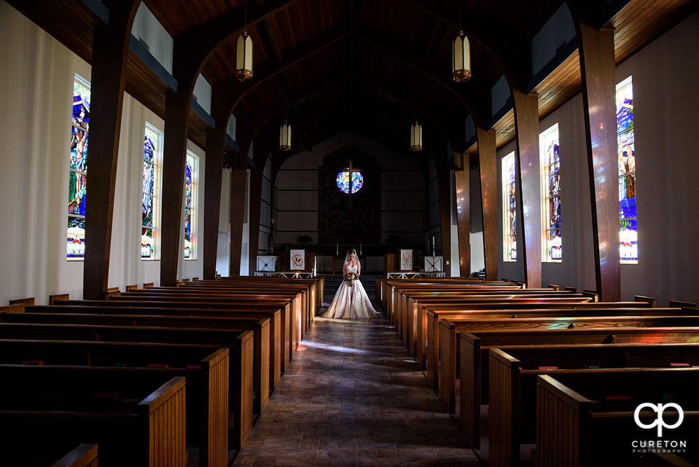 Bride in the sanctuary at Mauldin United Methodist after their wedding.