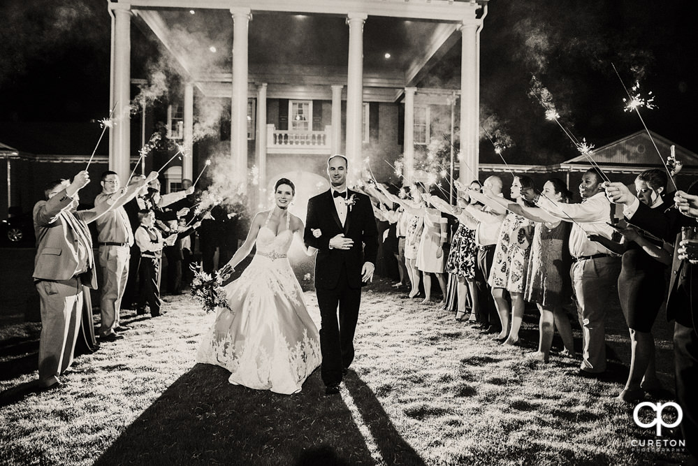 Bride and groom's sparkler leave at the Holly Tree Country Club wedding reception.