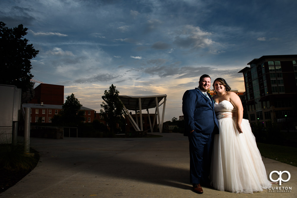 Bride and groom at sunset during the wedding reception at Huguenot Loft in downtown Greenville.