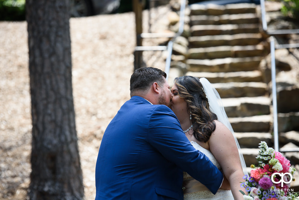Bride and groom having a first look in the Rock Quarry Garden before their wedding in downtown Greenville.