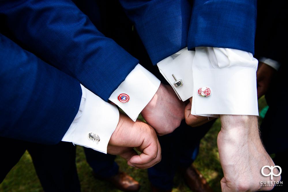 Custom super hero cufflinks for the groomsmen.