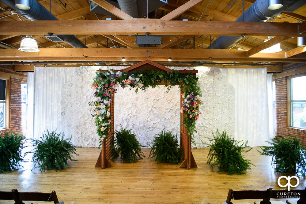 Floral decorated arbor for the ceremony at Huguenot Loft.