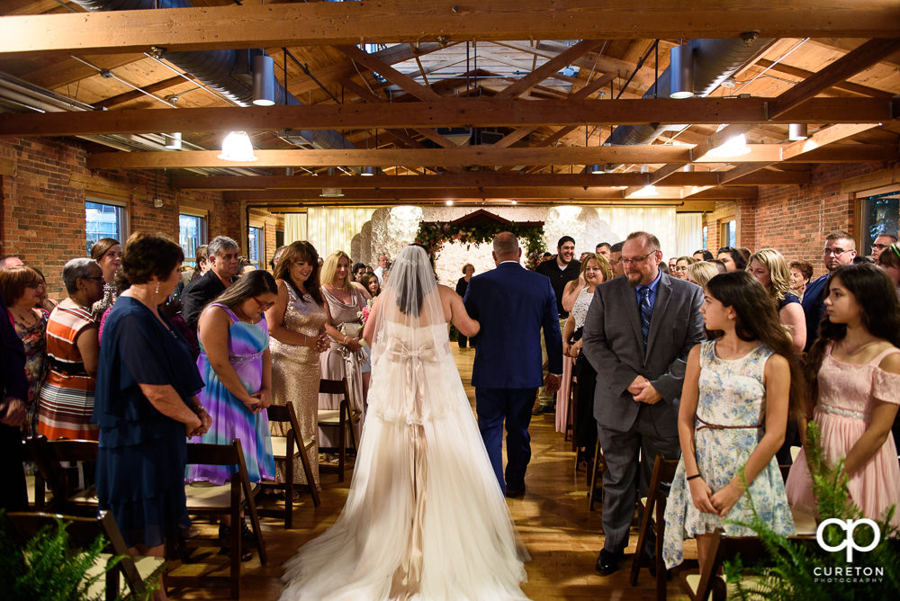 Bride and her father walking down the aisle at the Huguenot Loft wedding in Greenville,SC