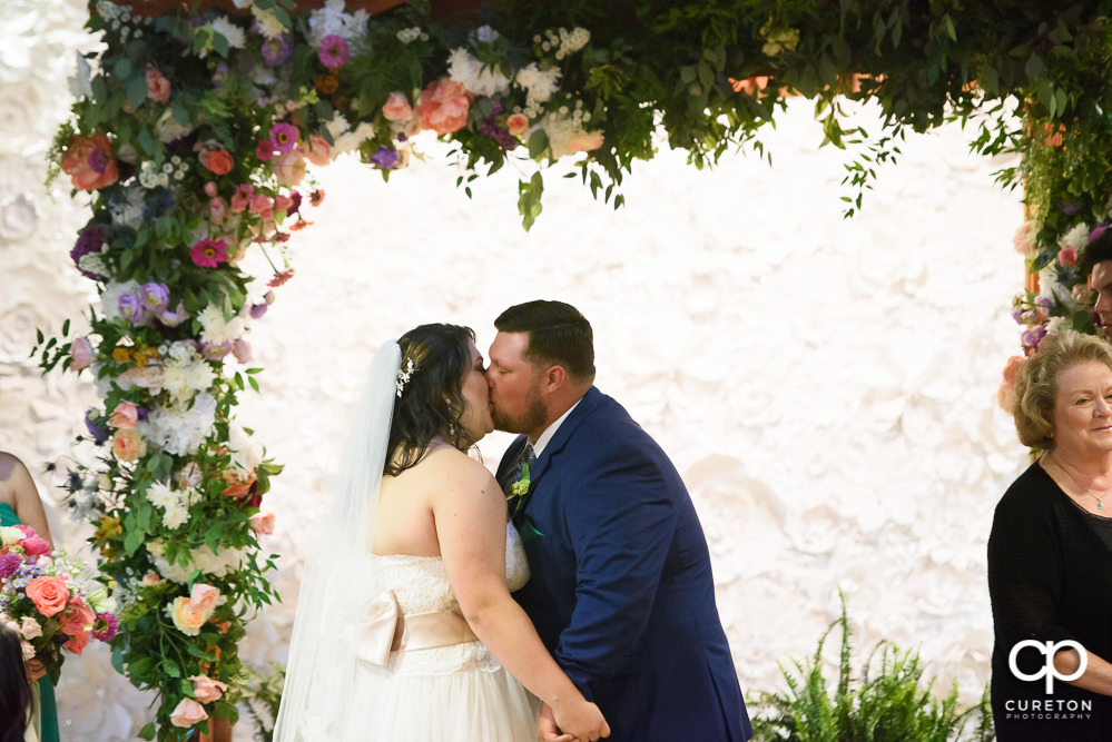 First kiss at the wedding ceremony.