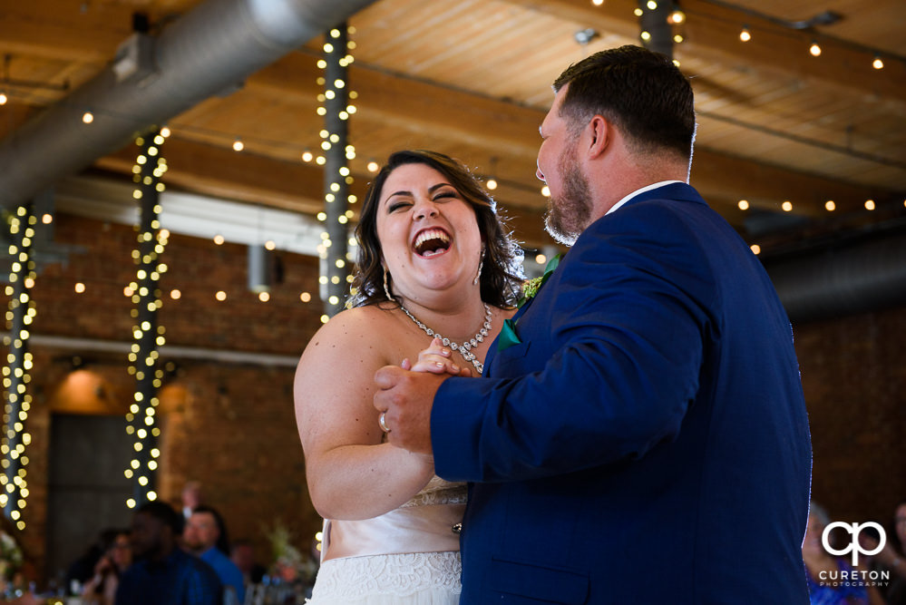 Bride and groom having a first dance at their reception.