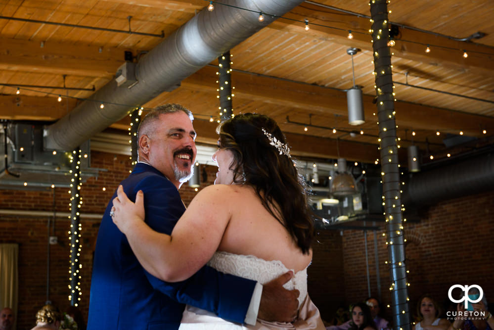 Bride and her father having a dance at the reception.