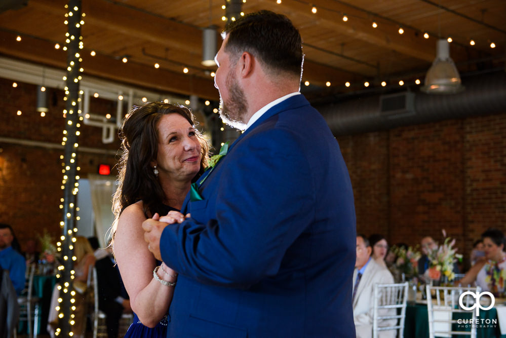 Groom and his mom having a dance at the reception.