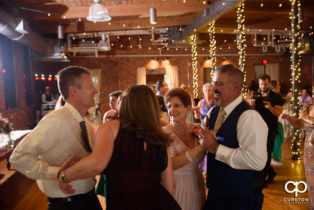 Guests dancing at the Huguenot Loft wedding reception in Greenville SC.