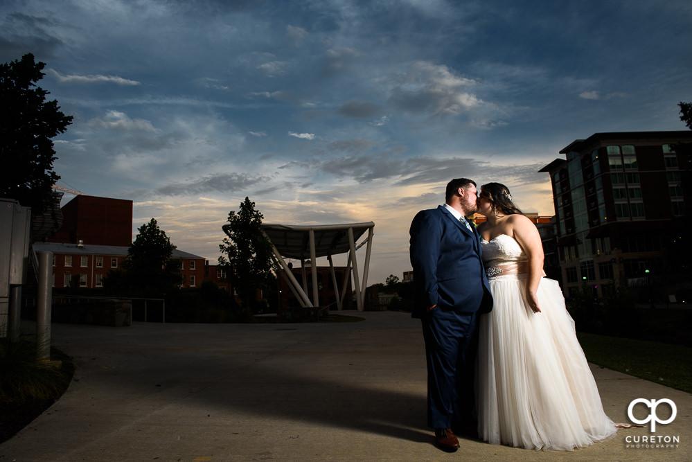 Bride at groom at sunset.