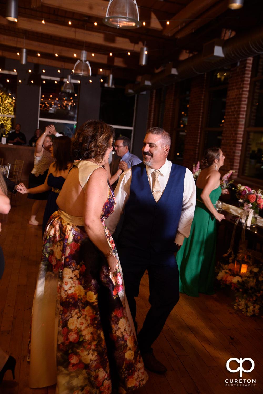 Wedding guests dancing.