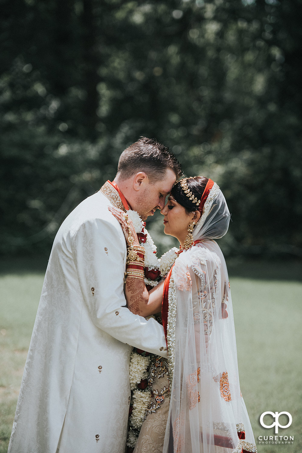 Bride and groom outside after their Indian wedding at Embassy Suites in Greenville,SC.