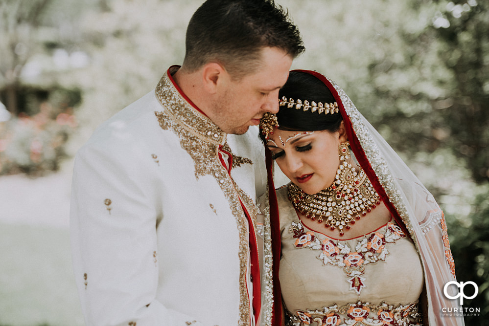 Bride leaning on her groom after their Indian wedding at Embassy Suites in Greenville,SC.