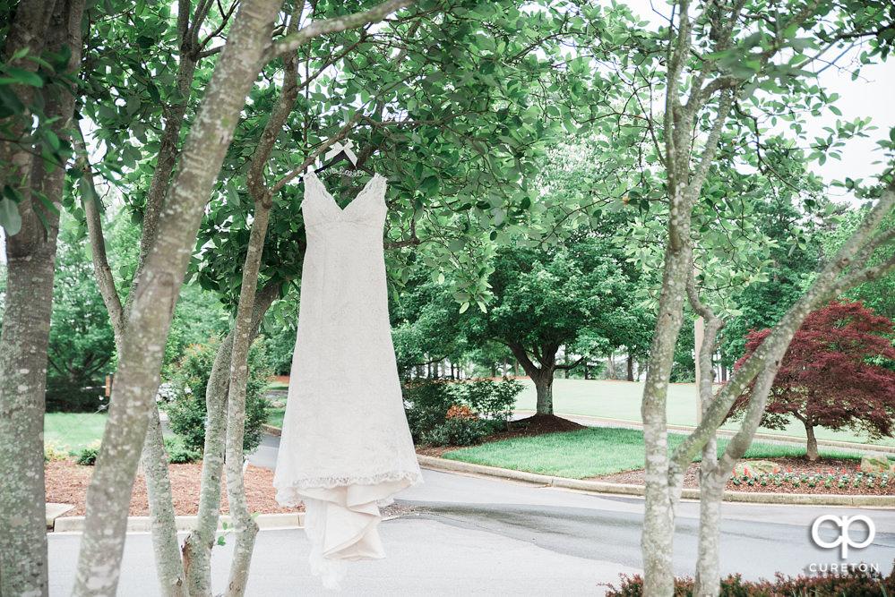 Wedding dress hanging.