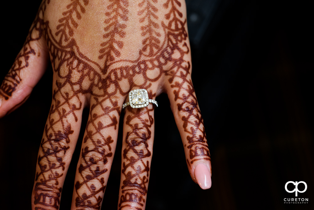 Wedding ring on a henna covered hand.