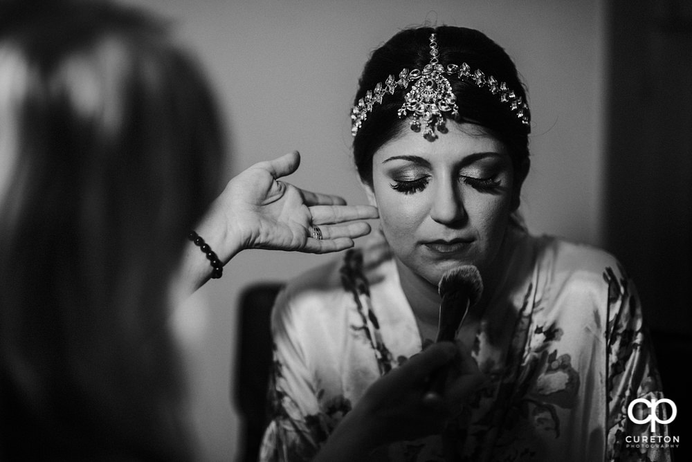 Indian bride getting makeup done by Cotton Rouge and Co.