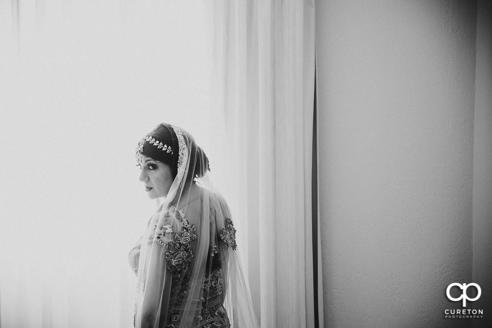 Indian bride in the window.
