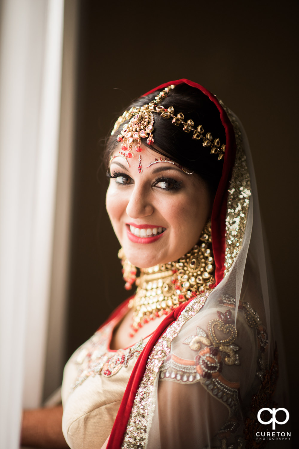 Indian bride getting ready for her wedding at Embassy Suites in Greenville.