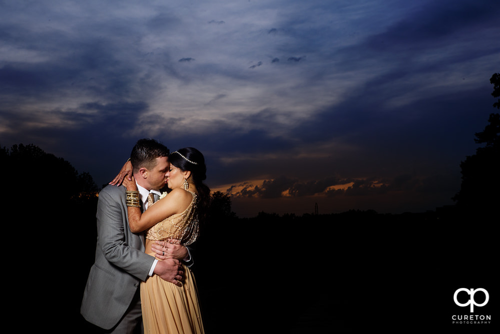 Bride and groom at sunset after their Greenville Indian wedding.