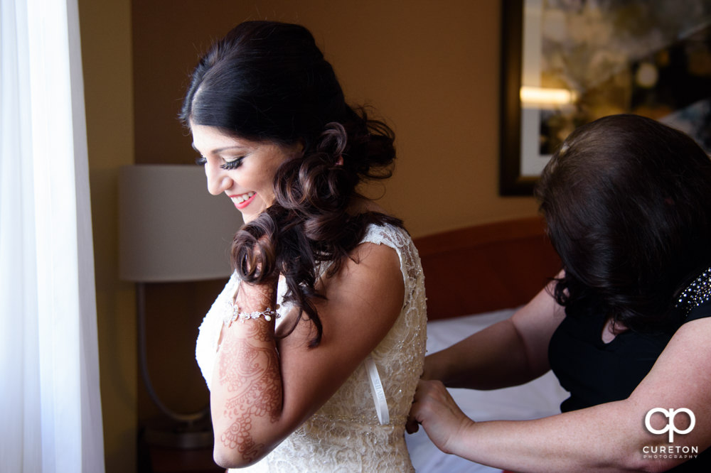 Indian bride getting ready for the second American wedding ceremony of the day.