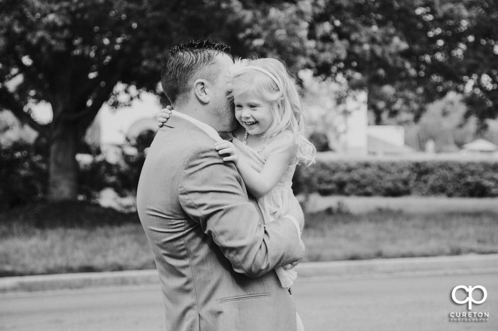 Groom and his daughter.