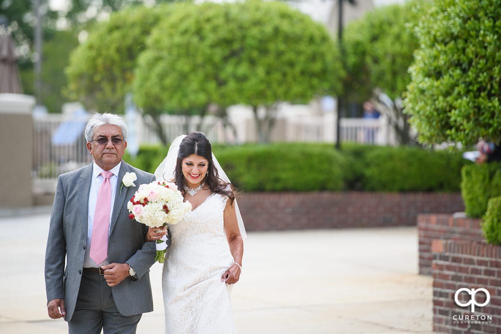 Outdoor wedding ceremony at Embassy Suites.