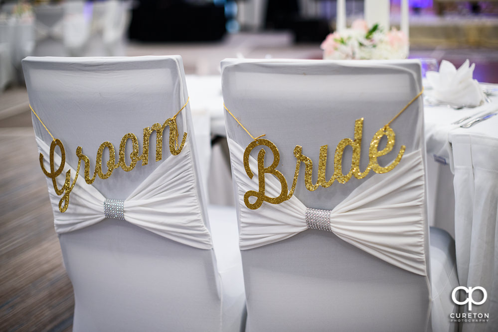 Bride and groom's chairs.